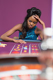 Woman looking upset at roulette table