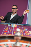 Man in sunglasses at roulette table