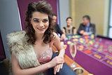 Woman in fur taking break from roulette