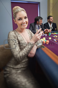 Blonde looking up from roulette table