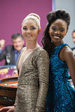 Two women standing beside roulette table