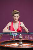 Woman playing roulette with champagne