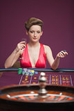 Woman playing roulette alone