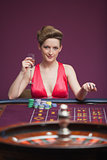 Woman sitting and playing roulette