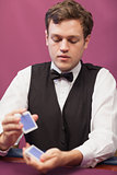 Dealer in a casino shuffling cards