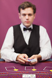 Dealer about to deal in poker game