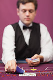 Dealer in a casino distributing cards