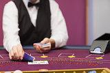 Dealer dealing cards in a casino
