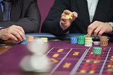 Two men placing roulette bets