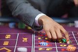 Man in casino placing bet