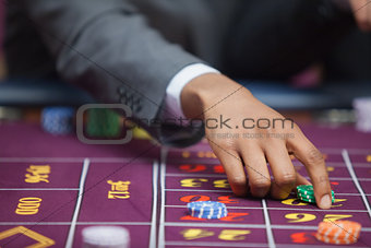 Man in casino placing bet