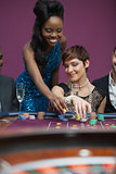 Two people playing roulette