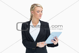 Blonde looking at her tablet