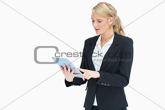 Blonde woman touching on her tablet