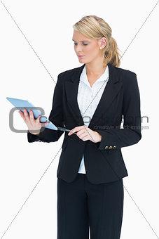 Blonde planning on her tablet