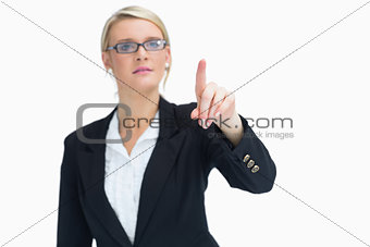 Blonde woman pointing in the air