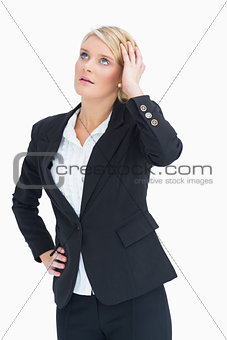Woman looking up while touching her head