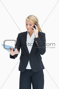Blonde looking at her tablet while calling