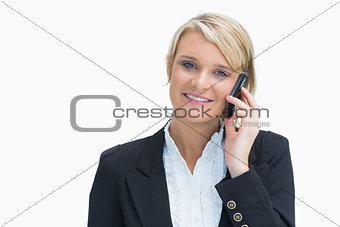 Woman phoning while smiling