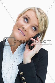 Blonde smiling while calling
