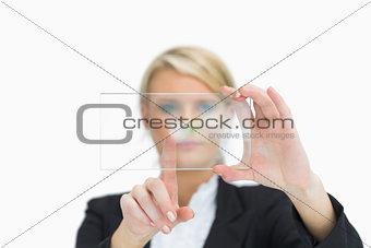 Blonde woman touching glass pane