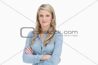 Blonde woman having arms crossed