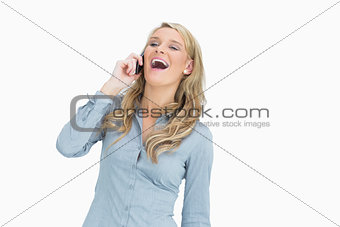 Woman laughing while calling
