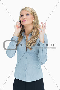 Woman explaining on the telephone