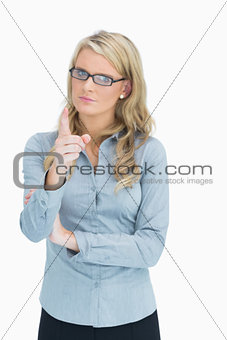 Blonde with glasses pointing