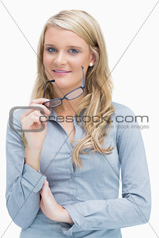 Woman removing glasses