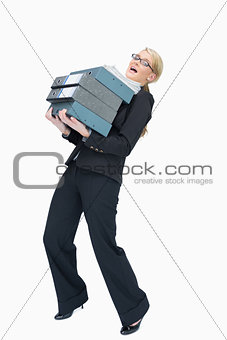 Businesswoman carrying folders