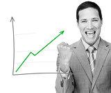 Man celebrating behind graph