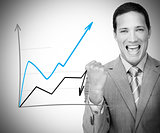 Businessman standing behind graph cheering