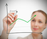 Woman drawing growth graph