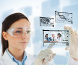 Woman selecting medical images from hologram interface