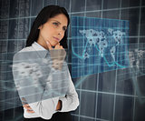 Businesswoman looking thoughtfully at world map