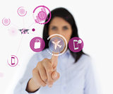 Woman selecting airplane symbol from purple interface