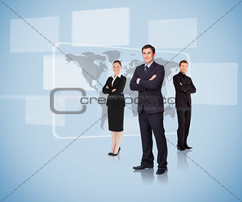 Business people standing in front of a map