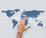 Hand pointing on world map