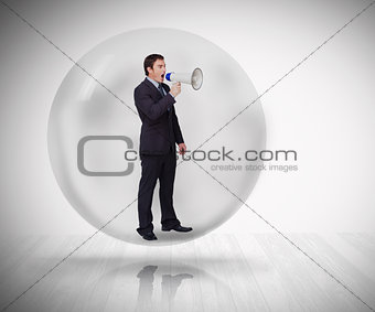 Businessman standing at a bubble
