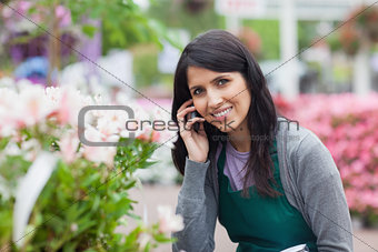 Smiling florist outside the garden centre