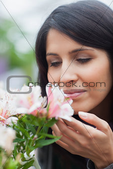 Woman smelling at the flower