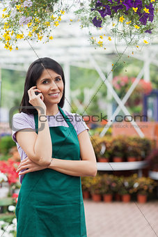Florist doing a phone call while smiling