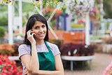 Woman working in garden center making a call