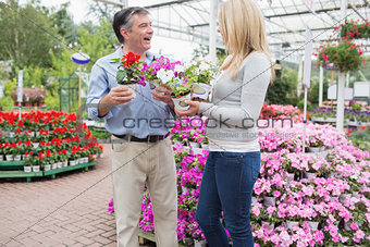 Couple talking while choosing plants