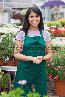 Happy assistant in garden center