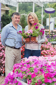 Cheerful couple choosing flowers