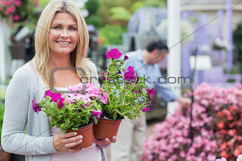 Customer holding flowers while smiling