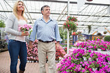 Couple walking around garden center