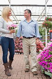 Couple walking through the garden center